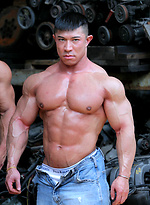 Muscled asian man Daryl Gee posing