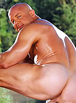 Bald muscle man Luke Garrett naked